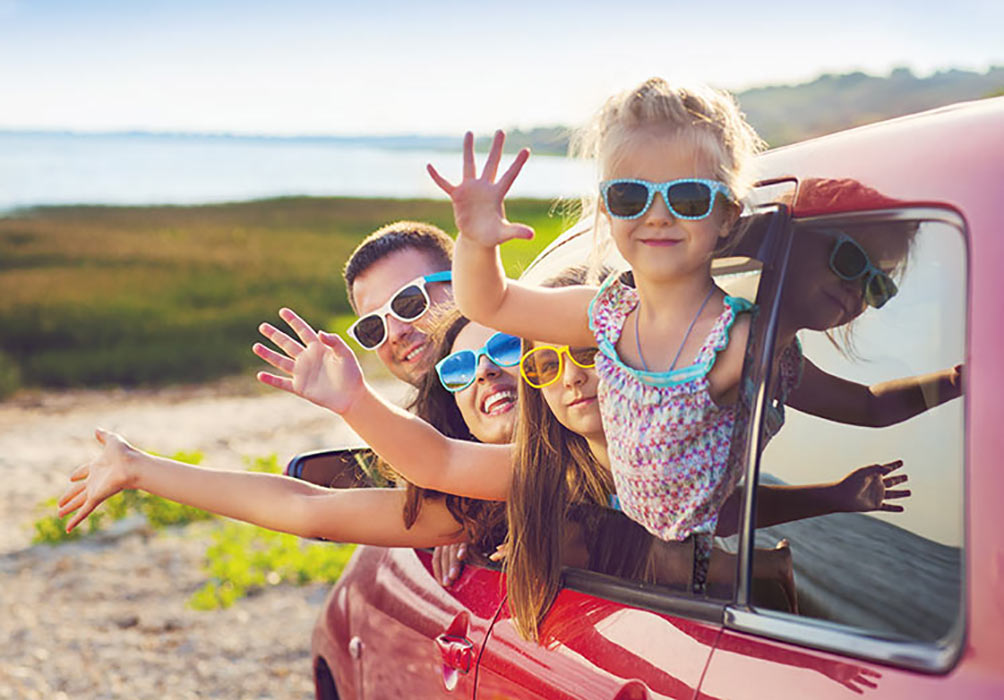 Family on holiday in car