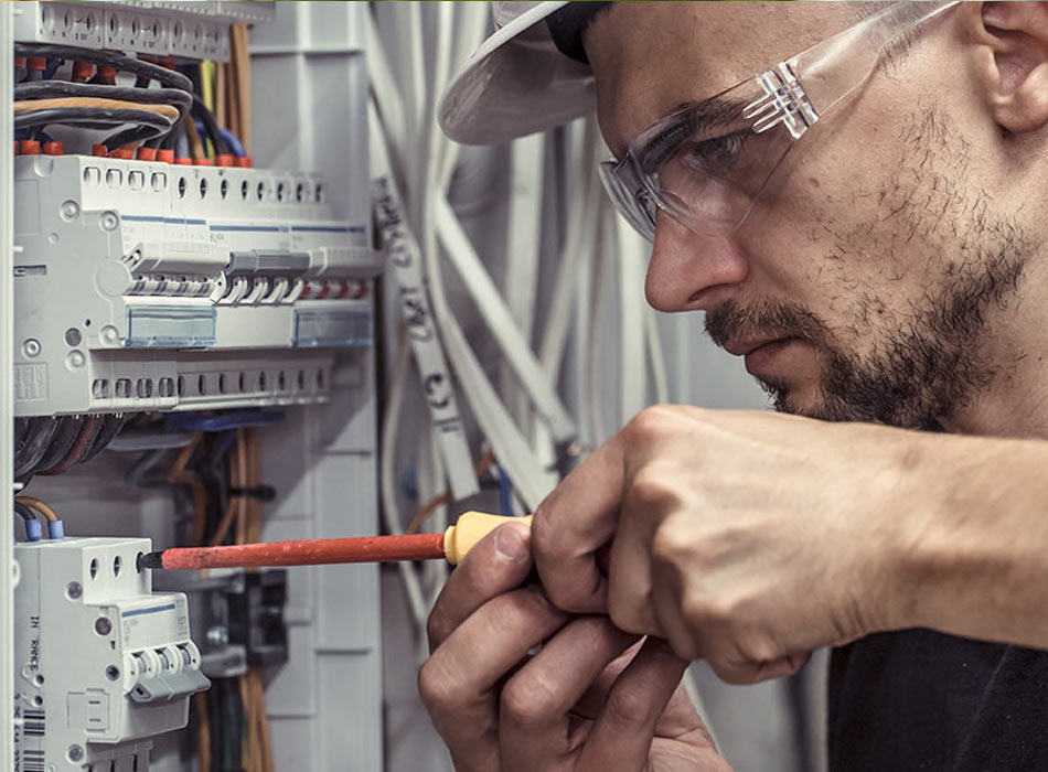 Electrician fixing fuse board