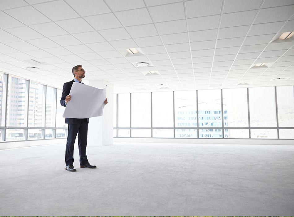 Architect standing in vacant commercial property